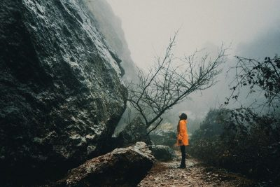 Facing an uphill struggle in fog, indicating fear of loneliness
